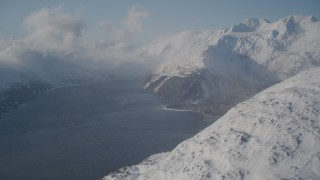 AK0001_1909 - 4K stock footage aerial video Passage Canal surrounded by snowy Chugach Mountains, Alaska