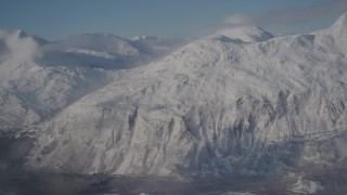 AK0001_1911 - 4K stock footage aerial video panning across snow covered Chugach Mountains, Alaska