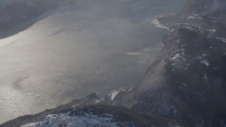 AK0001_1912 - 4K stock footage aerial video the windblown Passage Canal near a snowy, hilly valley, Alaska