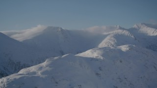 AK0001_1919 - 4K stock footage aerial video flying past snow covered mountain ranges in Chugach Mountains, Alaska
