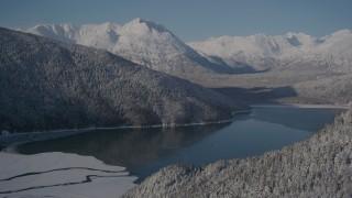 AK0001_1922 - 4K stock footage aerial video descend toward Carmen Lake, snowy Chugach Mountains, Alaska