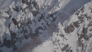 AK0001_1951 - 4K stock footage aerial video a snowy ridge with mountain goats, Chugach Mountains, Alaska