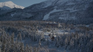 AK0001_1961 - 4K stock footage aerial video approach snowy Alyeska Resort surrounded by forest, Girdwood, Alaska