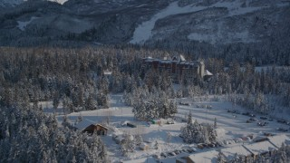 AK0001_1962 - 4K stock footage aerial video the Alyeska Resort, tilt up to ski lodge, snowy summit, Girdwood, Alaska