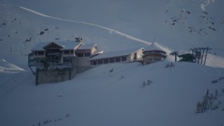 AK0001_1963 - 4K stock footage aerial video flying away from snow covered ski lodge at summit, Girdwood, Alaska