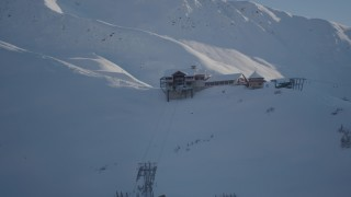 AK0001_1964 - 4K stock footage aerial video orbiting a snow covered ski lodge at the summit, Girdwood, Alaska