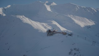 AK0001_1966 - 4K stock footage aerial video snow covered ski lodge and ski lift at summit of mountain, Girdwood, Alaska