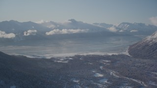 AK0001_1969 - 4K stock footage aerial video the snow covered Kenai Mountains with low cloud cover, Girdwood, Alaska