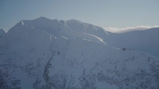 AK0001_1970 - 4K stock footage aerial video flying away from a snow covered mountain peak, Girdwood, Alaska