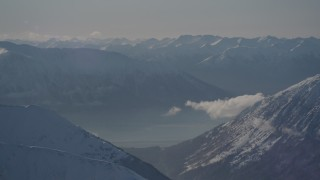 AK0001_1979 - 4K stock footage aerial video snowy, windblown Kenai Mountains, Turnagain Arm of the Cook Inlet, Alaska