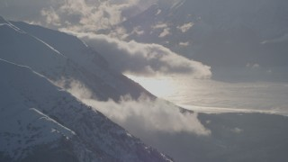 AK0001_1982 - 4K stock footage aerial video low clouds around snow covered Chugach  and Kenai Mountains, Alaska