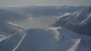 AK0001_1983 - 4K stock footage aerial video snowy Kenai Mountains across Turnagain Arm of the Cook Inlet, Alaska