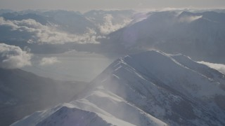 AK0001_1984 - 4K stock footage aerial video snowy Kenai Mountains across the Turnagain Arm of the Cook Inlet, Alaska