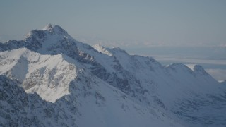 AK0001_1986 - 4K stock footage aerial video snowy Chugach Mountains, Knik Arm of the Cook inlet, Alaska