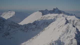 AK0001_1987 - 4K stock footage aerial video flying over the snow covered Chugach Mountains, Alaska
