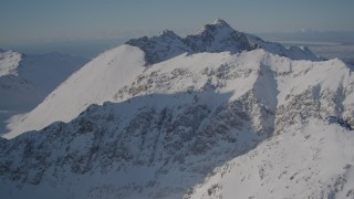 AK0001_1988 - 4K stock footage aerial video flying over the snow covered Chugach Mountains, Alaska