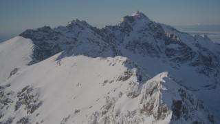 AK0001_1990 - 4K stock footage aerial video flying over the snow covered Chugach Mountains, Alaska