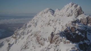 AK0001_1993 - 4K stock footage aerial video flying over snowy summit of a peak in the Chugach Mountains, Alaska