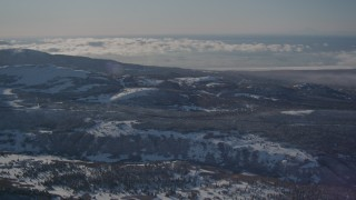 AK0001_2001 - 4K stock footage aerial video rolling hills and forests near the Chugach Mountains, Alaska in snow