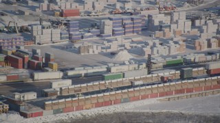 AK0001_2016 - 4K stock footage aerial video forklift behind snow covered cargo containers at the Port of Anchorage, Alaska