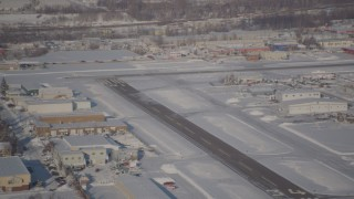 AK0001_2027 - 4K stock footage aerial video a small airplane taking off from snow covered Merrill Field, Anchorage, Alaska