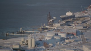 AK0001_2030 - 4K stock footage aerial video a cargo ship docked at Port of Anchorage in snow, Alaska