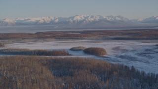 AK0001_2059 - 4K stock footage aerial video snowy Chugach Mountains, woods, Big Lake Area, Knik-Fairview, Alaska