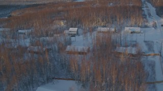 AK0001_2070 - 4K stock footage aerial video flying over snow covered residential neighborhood in Wasilla at sunset, Alaska