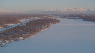 AK0001_2076 - 4K stock footage aerial video Lucile Lake, moon over snowy Chugach Mountains at sunset, Wasilla, Alaska