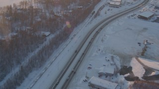 AK0001_2077 - 4K stock footage aerial video train by snowy neighborhoods, George Parks Highway, Wasilla, Alaska, sunset