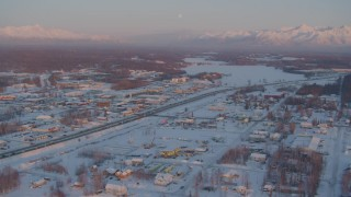 AK0001_2087 - 4K stock footage aerial video Lucile Lake toward Wasilla Lake with snow on the ground at twilight, Alaska
