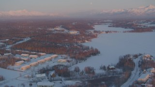 AK0001_2088 - 4K stock footage aerial video flying over snow covered Wasilla near Wasilla Lake at sunset, Alaska