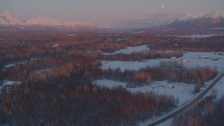 AK0001_2094 - 4K stock footage aerial video fly over snow covered neighborhoods, reveal mountains, Palmer, Alaska, twilight