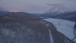 AK0001_2110 - 4K stock footage aerial video reveal snowy Matanuska River Valley, Chugach Mountains at sunset, Alaska