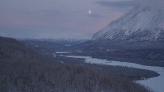 AK0001_2111 - 4K stock footage aerial video snowy Matanuska River Valley, reveal Chugach Mountains at twilight, Alaska