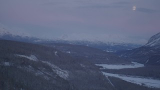 AK0001_2112 - 4K stock footage aerial video snowy, forested hills, Matanuska River Valley, Chugach Mountains, Alaska, twilight