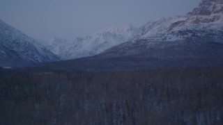 AK0001_2115 - 4K stock footage aerial video flying by snow covered Talkeetna Mountains at twilight, Alaska