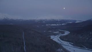 AK0001_2116 - 4K stock footage aerial video moon over snowy Talkeetna Mountains, Matanuska River Valley, Alaska, twilight
