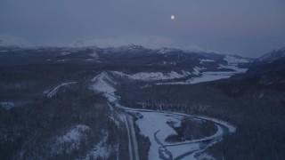 AK0001_2117 - 4K stock footage aerial video snowy Matanuska River Valley, moon over Talkeetna Mountains, Alaska, twilight