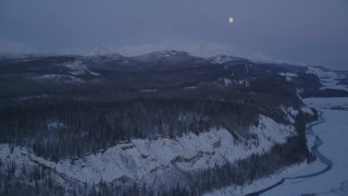 AK0001_2118 - 4K stock footage aerial video snowy Matanuska River Valley, moon over Talkeetna Mountains, Alaska, twilight