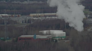 AK06_C033_1022TV - 4K aerial stock footage video tracking on a power plant, Anchorage, Alaska