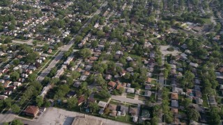 AX0001_003 - Aerial stock footage of 5K aerial  video flying over residential neighborhoods in Calumet City, Illinois, and reveal a shopping center