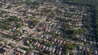 AX0001_004 - 5K stock footage aerial video reverse view of residential neighborhood with trees, Calumet City, Illinois