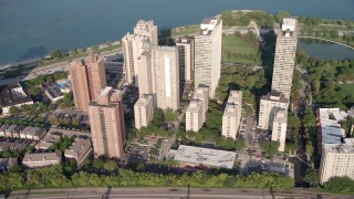 AX0001_012 - 5K stock footage aerial video passing a group of lakefront apartment buildings in Hyde Park, Chicago, Illinois