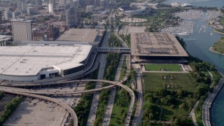 AX0001_018 - 5K stock footage aerial video tilt from Highway 41, reveal downtown skyline, McCormick Place, Soldier Field, Chicago, Illinois