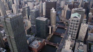 AX0001_047 - 5K stock footage aerial video following the Chicago River through downtown skyscrapers toward Marina City, Downtown Chicago, Illinois