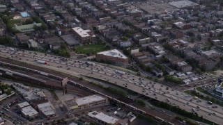 AX0001_060 - 5K stock footage aerial video pan across heavy traffic on Interstate 90 and 94, West Chicago, Illinois