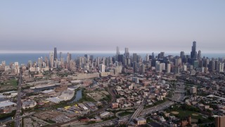 AX0001_063 - 5K stock footage aerial video the Downtown Chicago skyline seen from the west, on a hazy day, Illinois