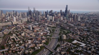 AX0001_064 - 5K stock footage aerial video tilt from streets by Interstate 90 and 94, revealing downtown skyline, Downtown Chicago, Illinois