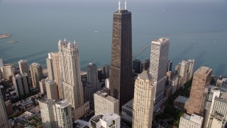 AX0001_086 - 5K stock footage aerial video tilt from high-rises to reveal John Hancock Center, Lake Michigan, Downtown Chicago, Illinois